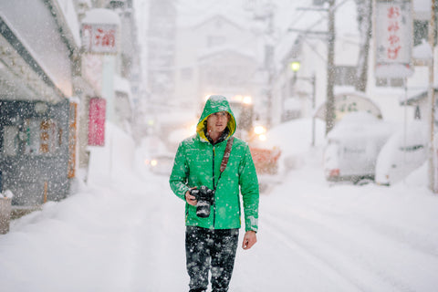 Photographer in Snow Storm with Leather Camera Strap