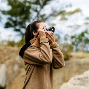 Outdoor Photographer using Vintage Camera Strap in Natural Cotton and Brown Leather