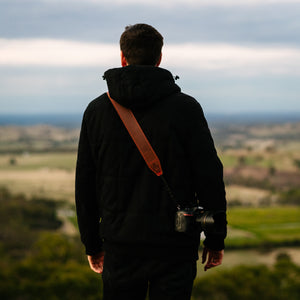 Photographer wearing the most comfortable Leather Camera Sling with Quick Release System