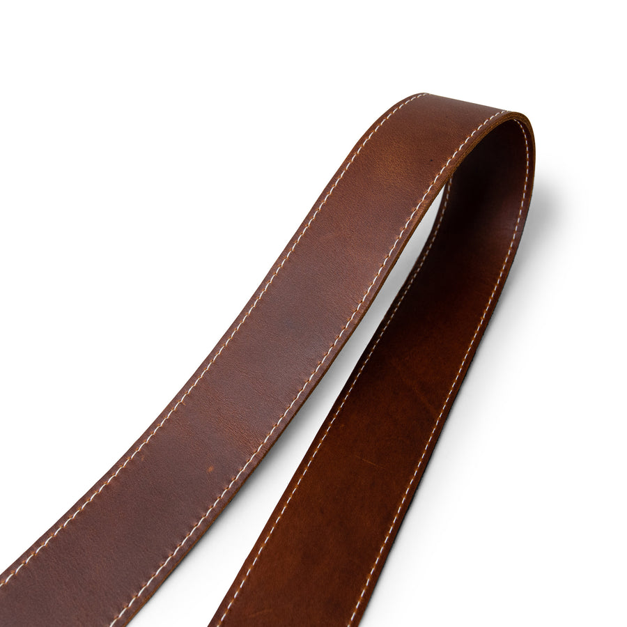 Close up of classic brown leather camera strap by lucky straps
