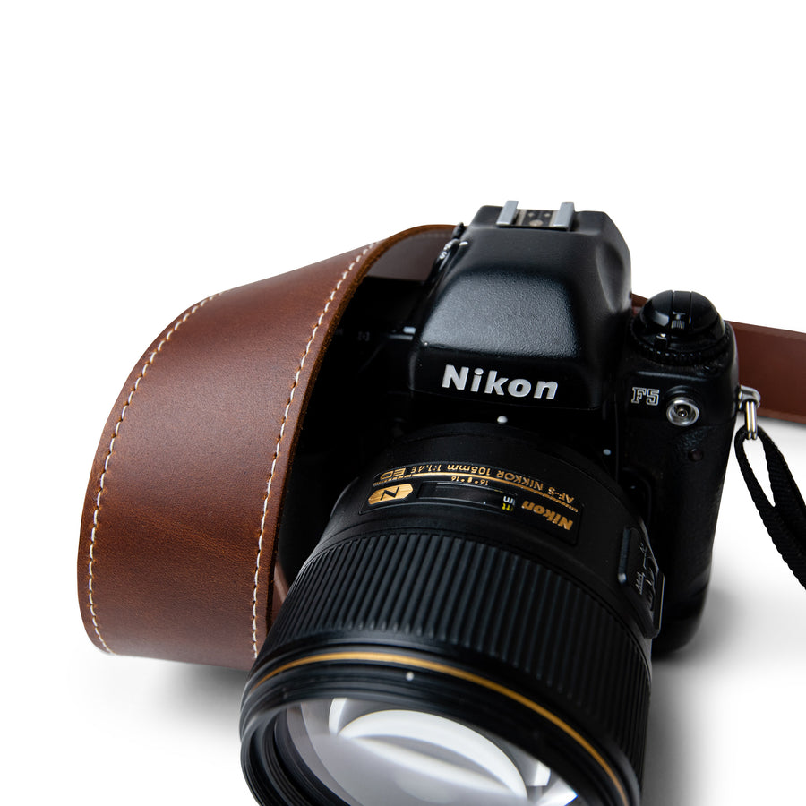 Classic Brown Leather Camera Strap with White Stitching for a retro camera