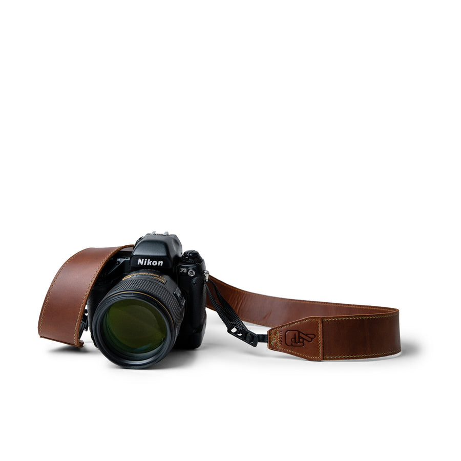 The most comfortable camera strap for dslr and mirrorless camera is a leather quick release strap from lucky straps