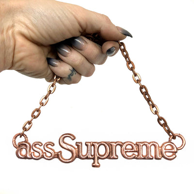 Ass Supreme, Auto Emblem Necklace. (Cutlass Supreme)