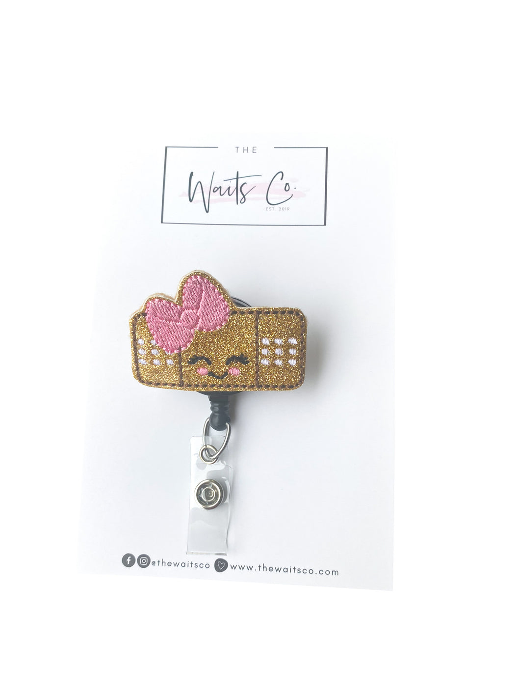 Bandaid Bow Badge Reel