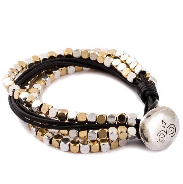 Trades by Haim Shahar - leather bracelet with gold and silver accents