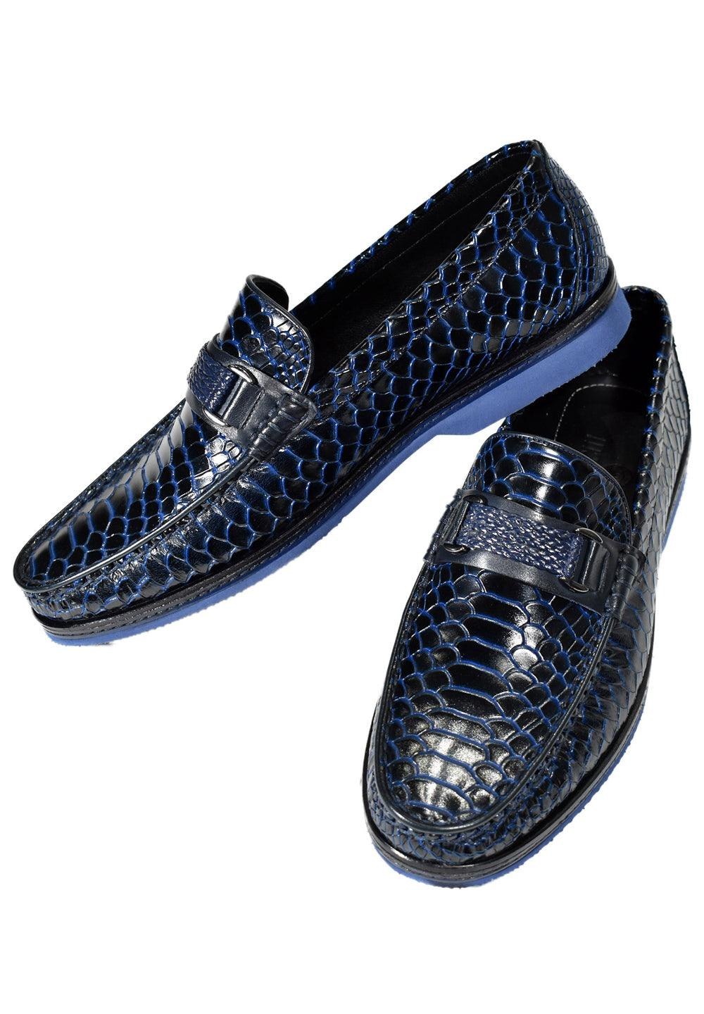 Marcello Stamped Python Shoes. Make a statement in this shaded python pattern on stamped leather. Unique braided hardware adds style. Lightweight comfort with a rubber sport sole. Classic fit. Shoes come with shoe trees, shoe horn and suede bag.