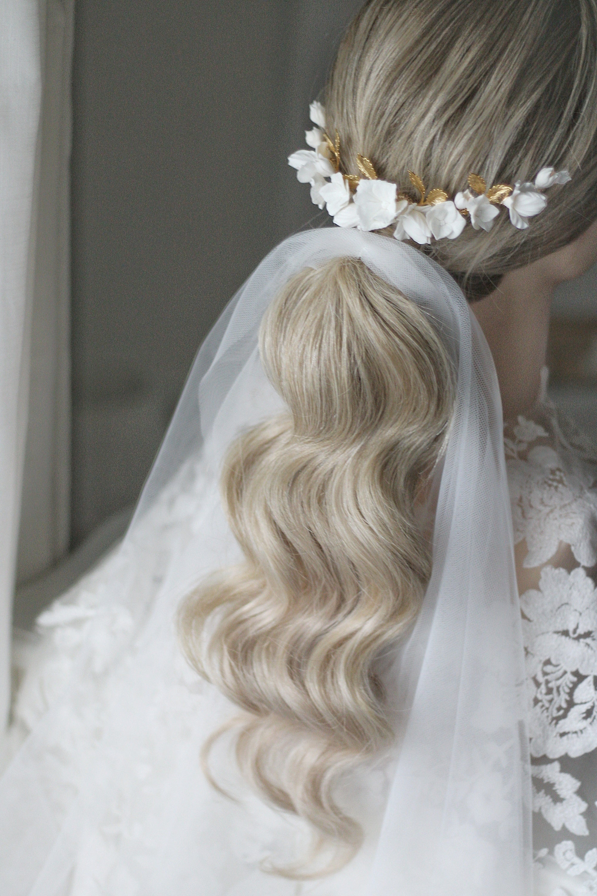 bespoke bridal headpiece with ponytail and ponytail veil