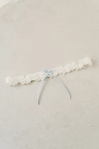 slim and thin lace wedding garter with blue bow