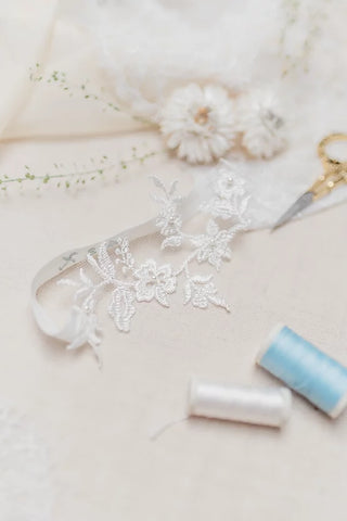 ivory lace wedding garter with blue personalised embroidery