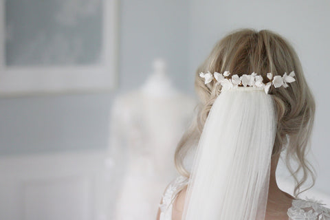 romantic wedding hairpiece styled with a silk style veil