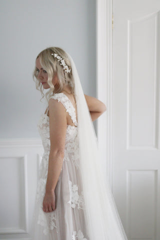 Soft veil and bridal headpiece on bride by Megan therese