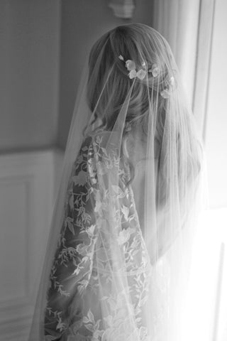 handmade clay flower bridal pins worn with a blusher wedding veil by megan therese