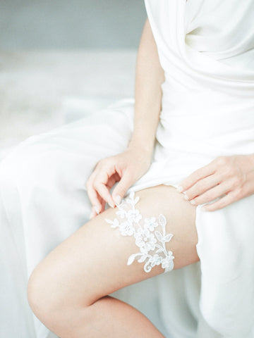 bride wears lace wedding garter by megan therese