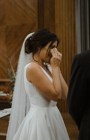 Real bride crying happy tears in pearl wedding veil by Megan therese