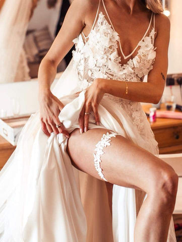bride wearing a lace wedding garter