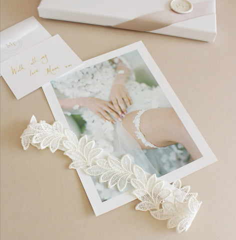 lace wedding garter with handwritten note