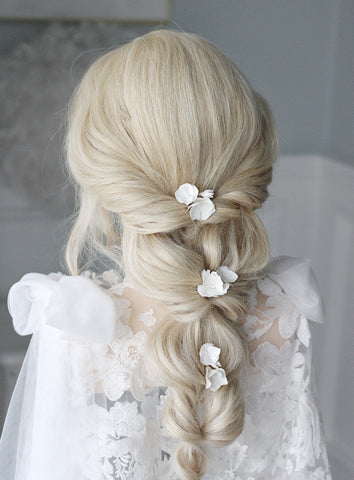 clay flower hair pins for the bride styled in a braid by megan therese