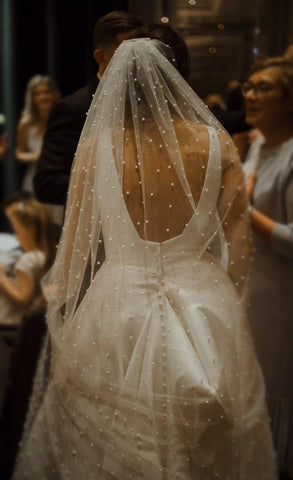 real bride wearing a statement pearl long veil