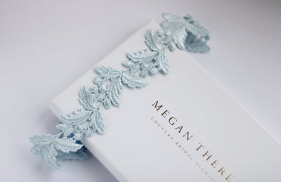 delicate sleek lace blue bridal garter with gift box