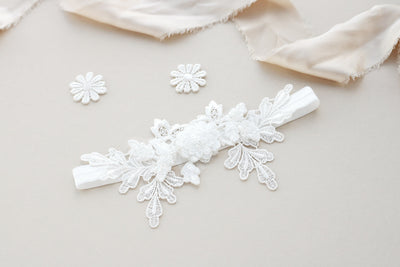 Luxury ivory Lace wedding garter on table