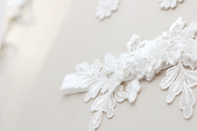 Close up picture of Luxury ivory Lace wedding garter