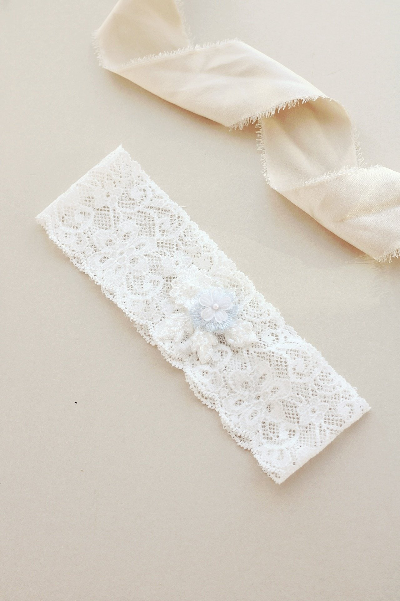 Soft lace wedding garter with something blue