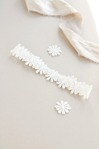 Sleek flat floral lace bridal garter