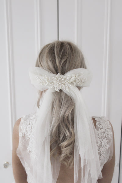 Oversized luxe bow