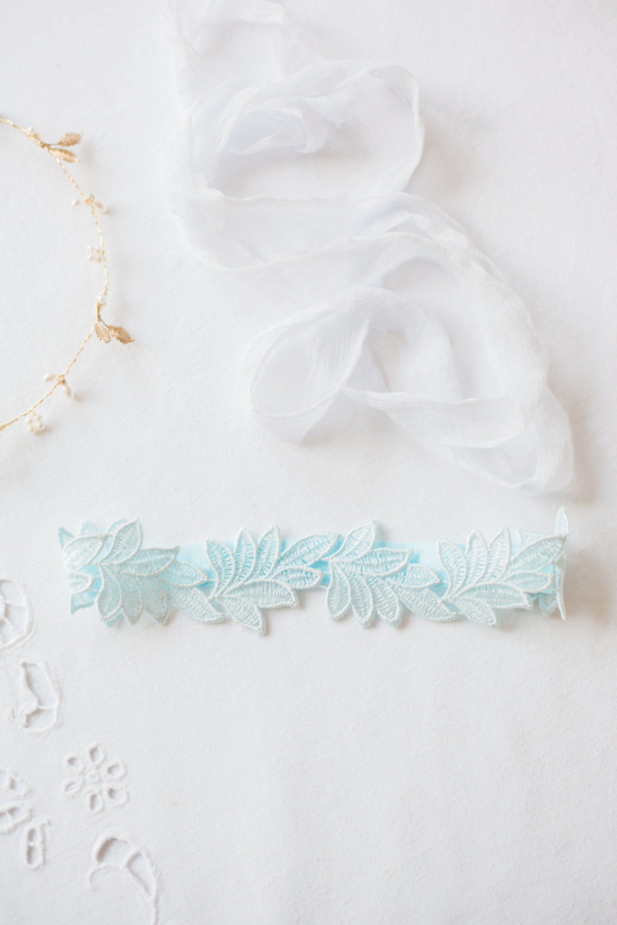 sleek blue lace leaf wedding garter