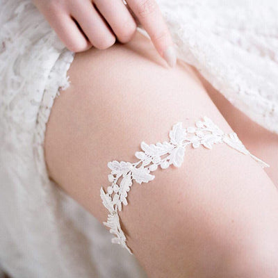 sleek and flat lace ivory wedding garter