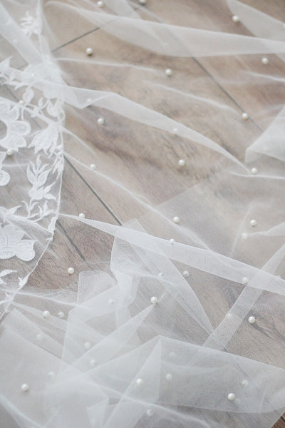 scattered pearl wedding veil on the floor
