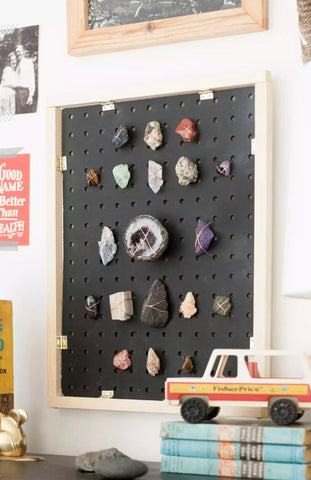 Pegboard and gemstone collection