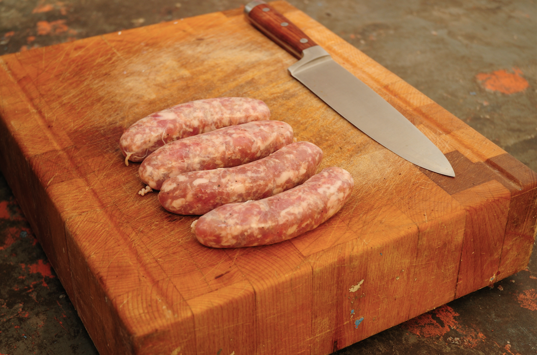 4 Toulouse sausage on chopping board