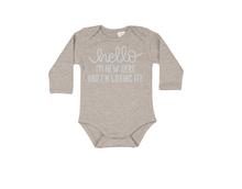 Load image into Gallery viewer, HELLO I'M NEW HERE AND I'M LOVING IT! Baby Long Sleeve Bodysuit