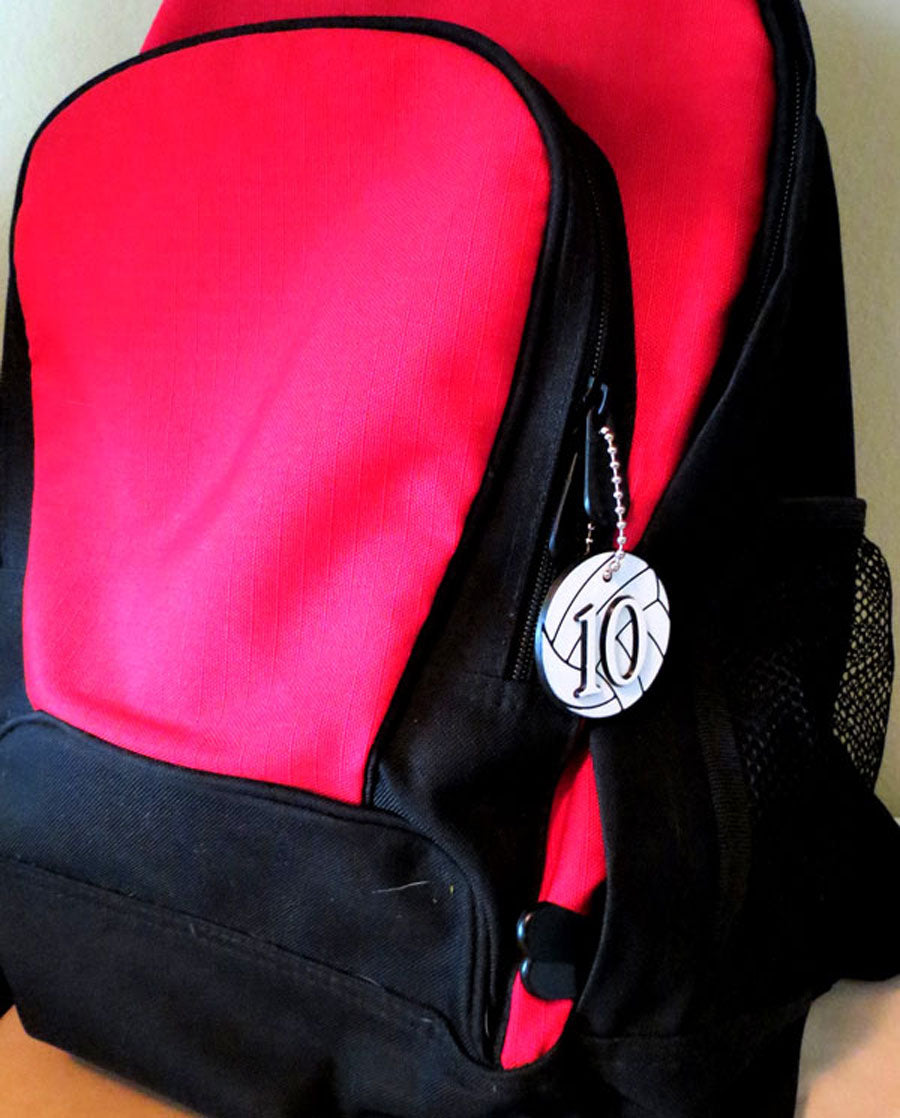 volleyball bag tag attached to backpack