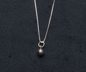 round sterling silver volleyball charm on silver necklace