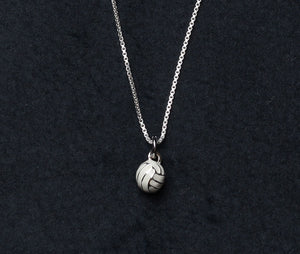 3D volleyball charm with silver and white enamel detail on sterling silver necklace