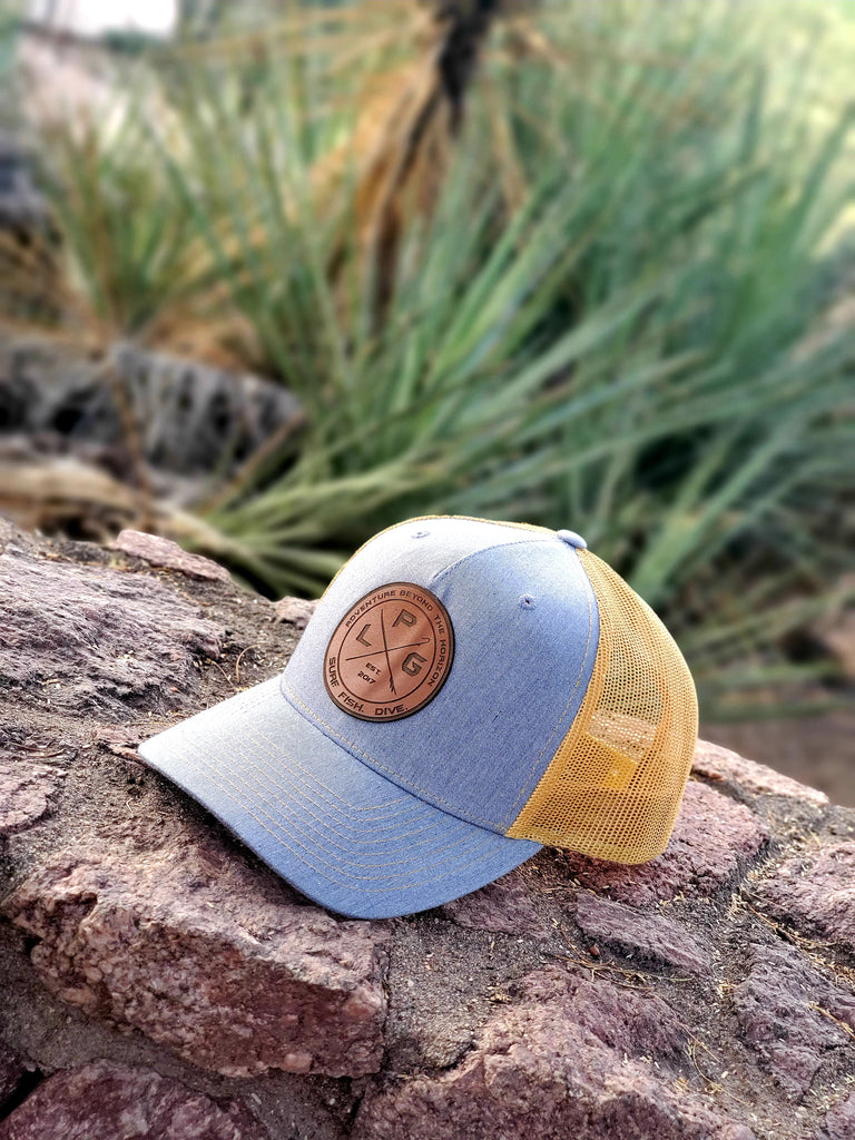 LPG Apparel Co. Crossed Gaff & Surfboard Heather Grey Amber Gold Snap Back Trucker Baseball Hat Fishing Hat, Surf Hat, Surfing Hat, Surf, Fishing apparel, Fishing accessories, Fishing Christmas Gift, Richardson Hat, Richardson 112FP