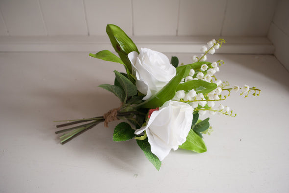 White rose and lily of the valley jam jar arrangement