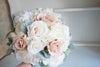 Romantic, blush and ivory wedding bouquet with lambs ear greenery.
