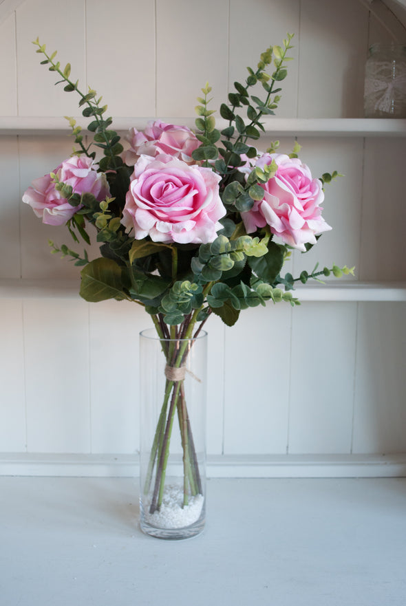 Luxury pink roses and eucalyptus silk flower tied arrangement.