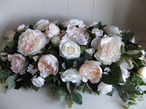 Pink and ivory silk flower table arrangement.