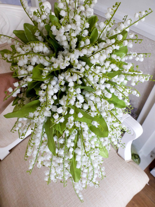 Luxury artificial lily of the valley teardrop wedding bouquet.