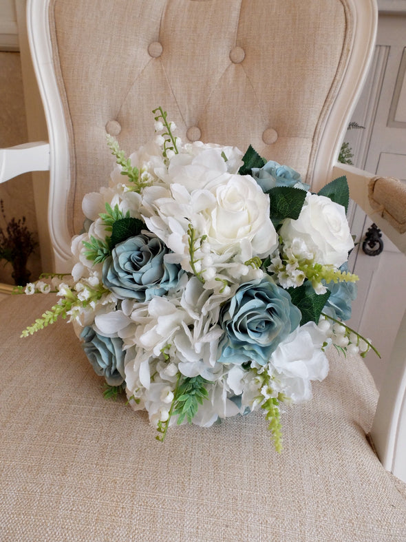 White and dusky teal silk wedding bouquet.