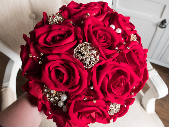 Red and gold silk wedding bouquet.