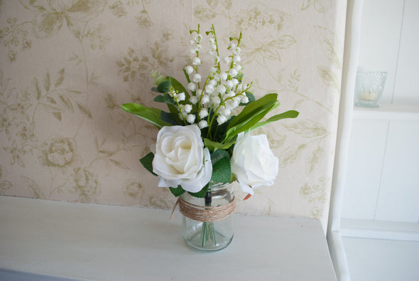 white flower arrangement wedding centrepiece