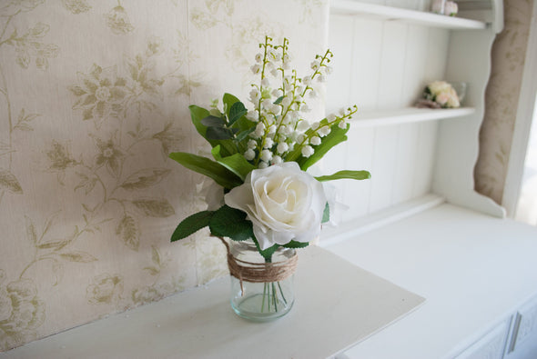 rose and lily of the valley jar arrangement