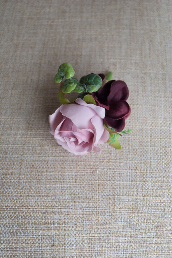 pink and burgundy rose buttonhole