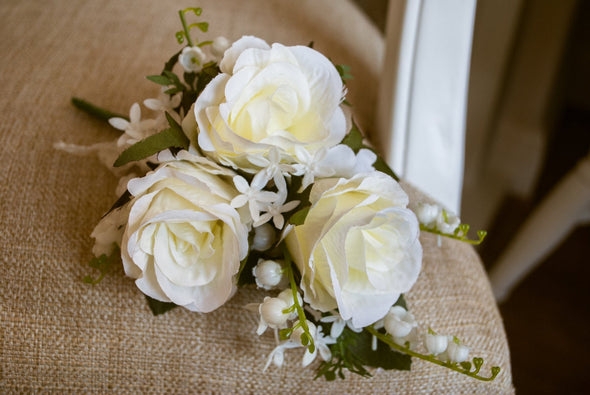 Ivory rose and lily of the valley silk wedding corsage.