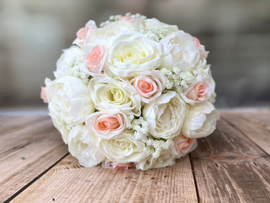 Blush pink and ivory silk wedding bouquet.